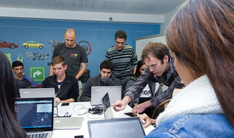 Students in Israel are led through the Hour of Code by eBay employees